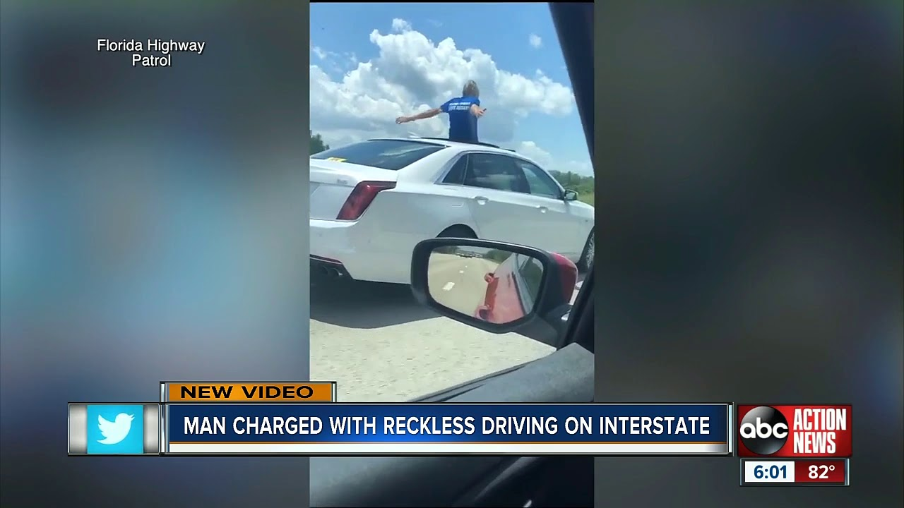 VIDEO: 70-Year Old Man Sits On His Car Sunroof Going 100mph