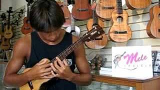 "Carlos Rock plays ""While My Guitar Gently Weeps"" on a Mele Ukulele tenor-4 string uke"