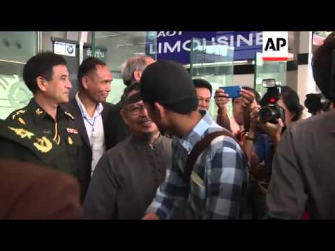 Thai nationals arrive in Bangkok after fleeing the escalating violence in Libya