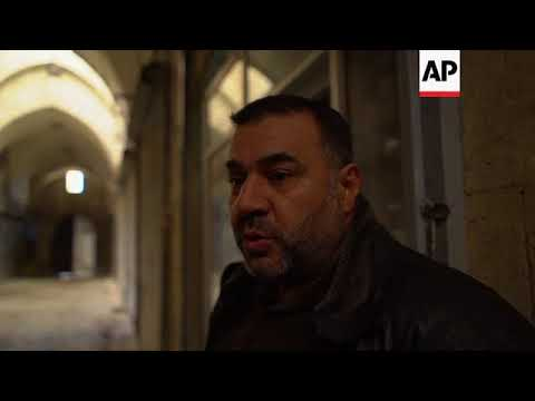 Shops reopen in Aleppo market despite still being in ruins