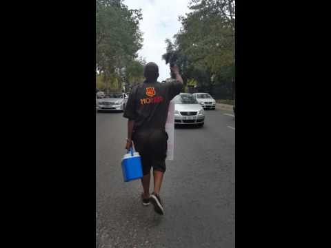 DJ Sbu sellss Mofaya Energy Drink in the streets