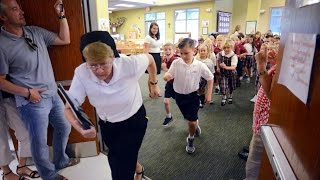 Students at St. Gregory the Great Catholic School get a free pass to run the hall in celebration of the first day of school on Tuesday.