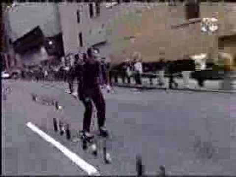 playing mozart on bottles using sticks on rollerblades