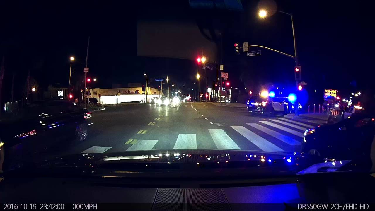 Police activity on Santa Monica Blvd / Doheny Dr  Beverly Hills police,  West Hollywood LA Sheriff,