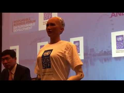 Sophia the robot answering questions at the Responsible Business Forum