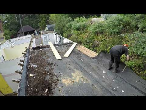 stripping-5-layers-of-roofing-felt-&-removing-2-upvc-patio-door-frames-&-moving-wood