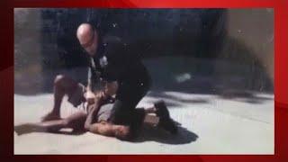 Video shows Schenectady cop kneeling on man