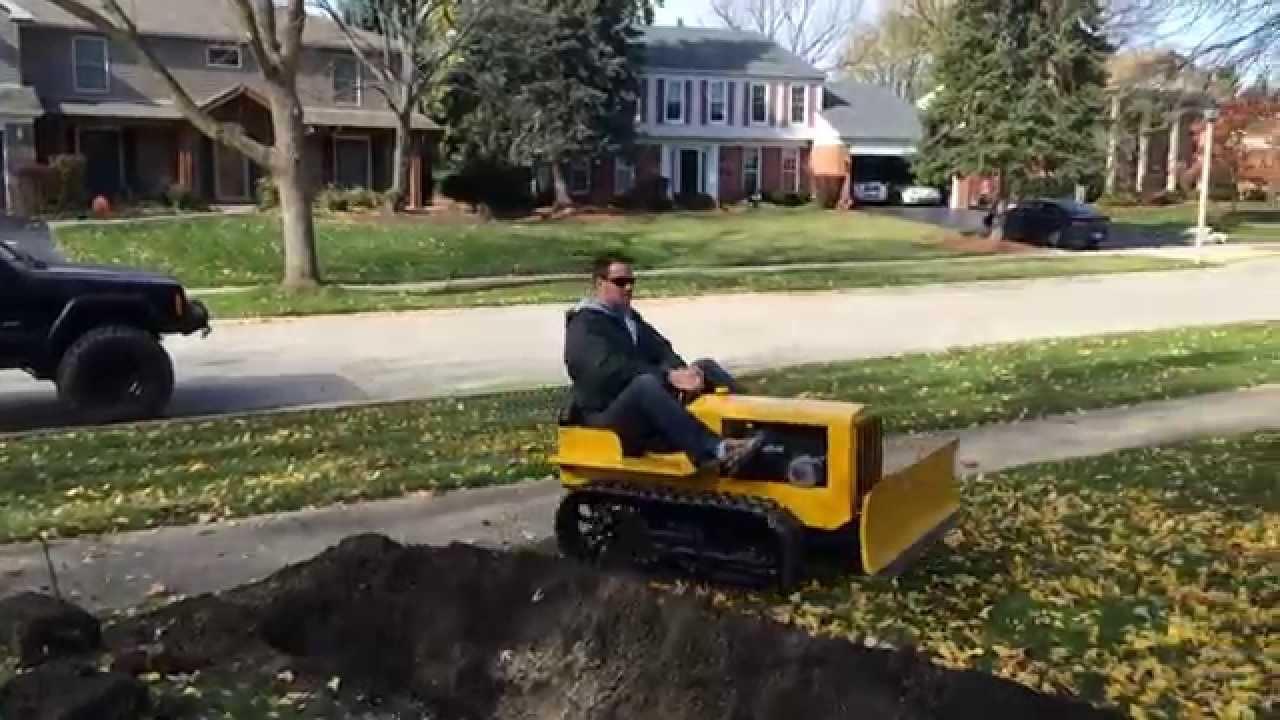 Caterpillar Replica Mini Dozer Plowing Dirt - YouTube