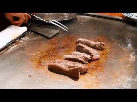 Chef preparing Kobe Beef and sides at Steak Land in Kobe, Japan