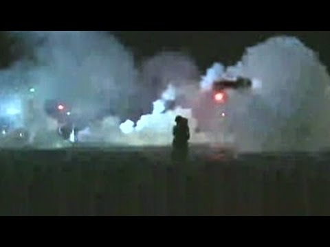 Ferguson police fire tear gas at protestors