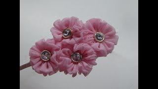 Diadema decorada con roseton de Tela