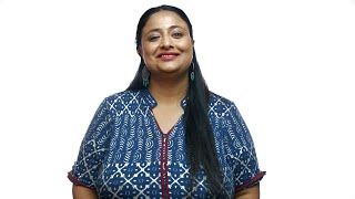 Overweight Indian woman looking towards the camera with a beautiful smile - White background