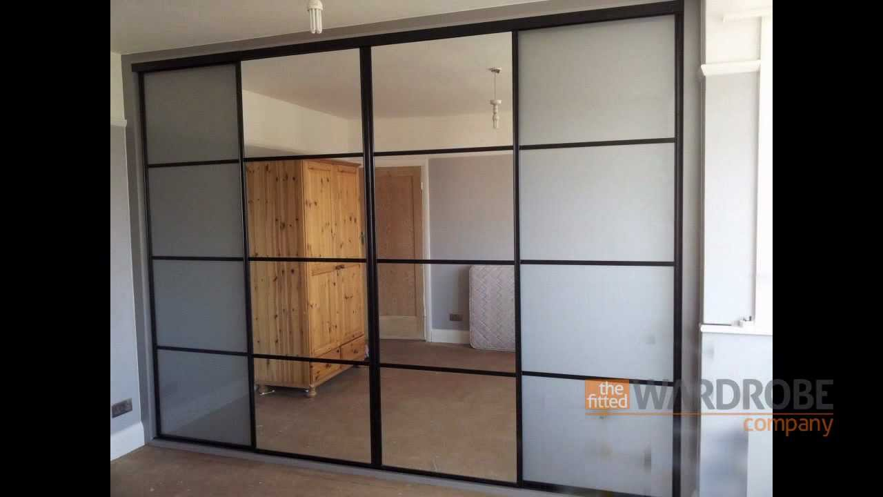Built in sliding door wardrobe pure white glass black for Black sliding glass doors
