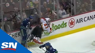 Mike Smith's Mask Goes Flying As Alex Edler Collides With Flames' Goalie thumbnail