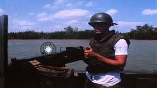 U.S. Sailors operating River Patrol boats on the Bassac River in Vietnam HD Stock Footage