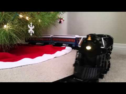 The Polar Express Lionel G Gauge Toy Train going around the Christmas Tree