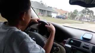 filipino 9 years old kid driving a lexus car for the first time shocking video