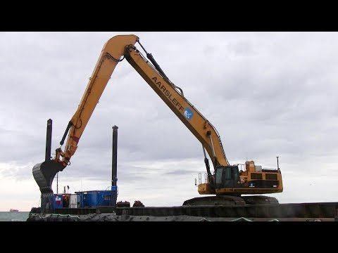 Cat 385C Long Reach Excavator Working On A Barge