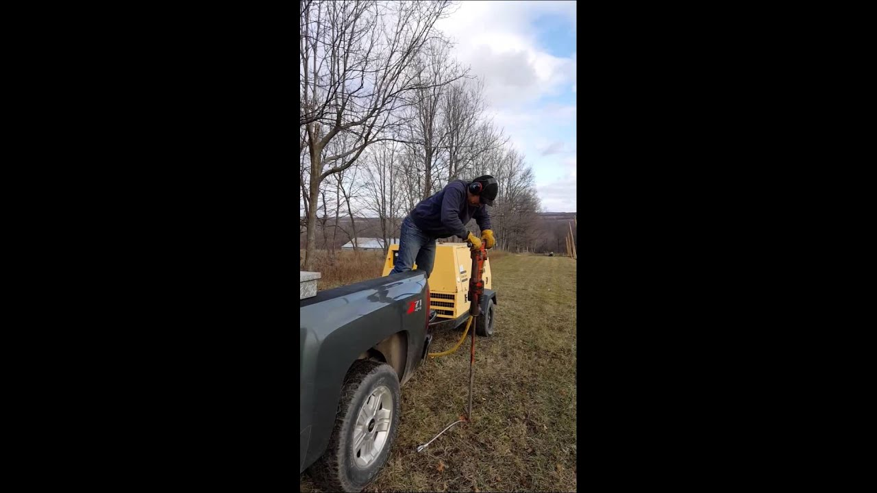Driving ground anchors with air hammer
