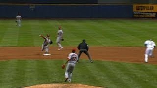 STL@MIL: Kozma trips over second turning double play