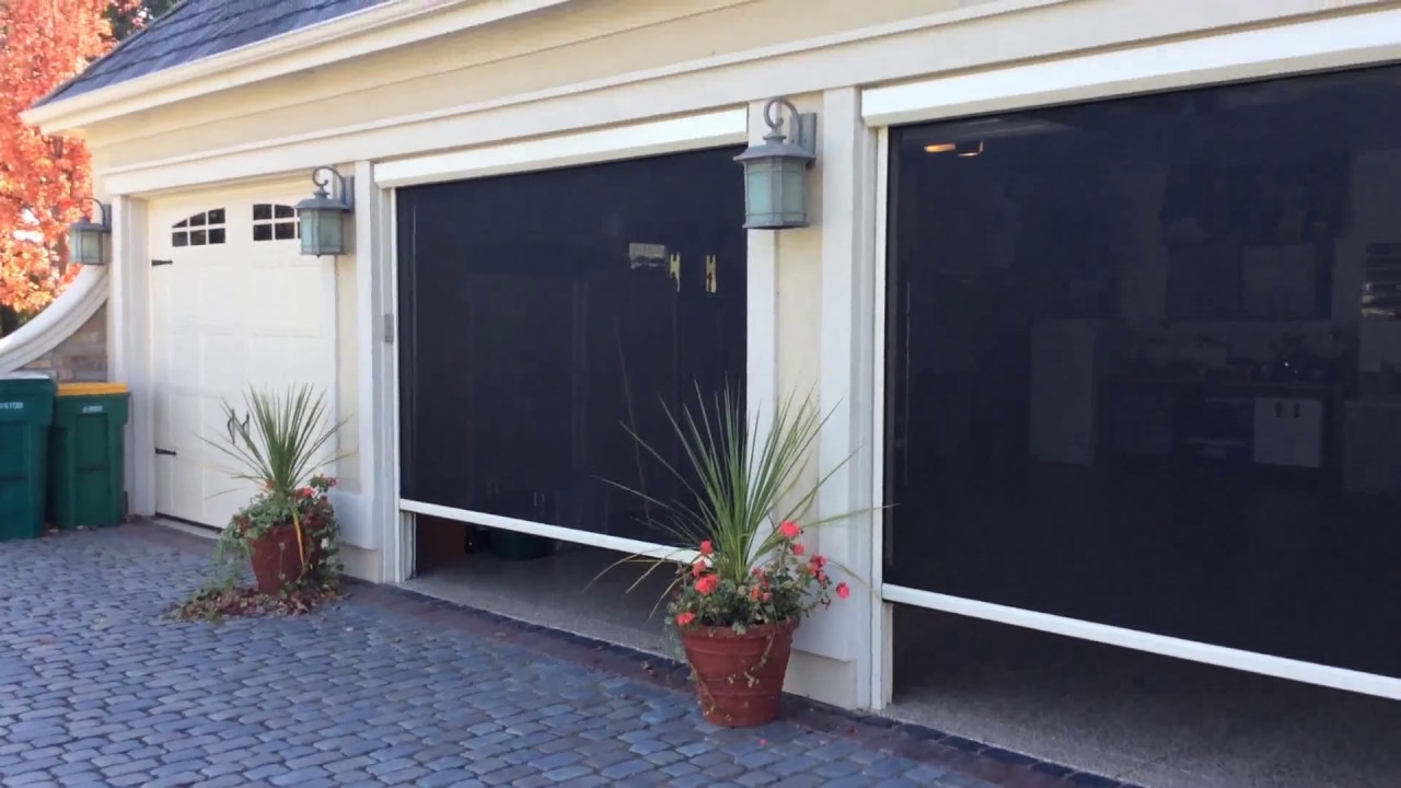 Phantom screens motorized screens for garage doors youtube for Motorized garage door screens