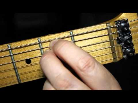 How to play guitar chords - Absolute beginners guitar lesson.