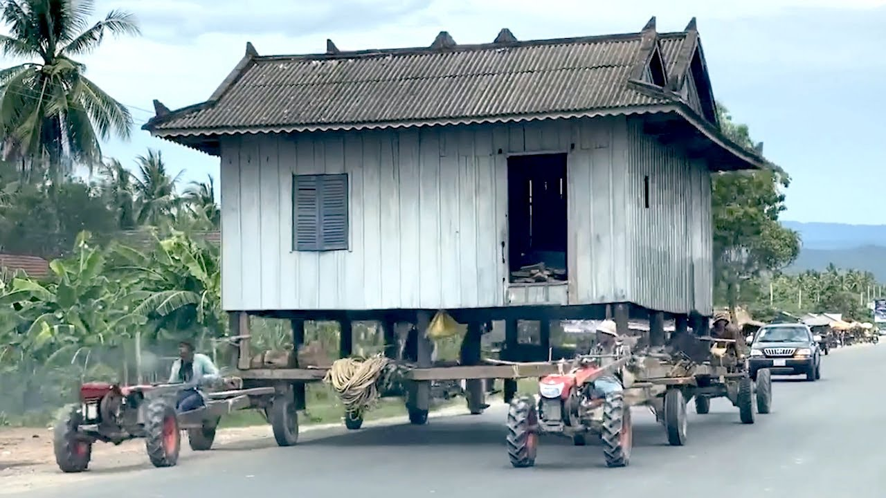 Need to relocate your house? A house being moved on road by tractors in Cambodia | Video