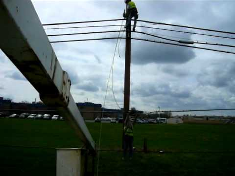 Linemen fixing down cable lines due to storm damage in northeast ohio 5/06/2011