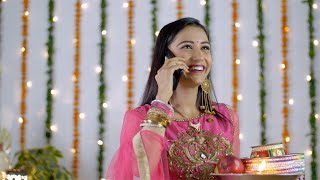 Indian married woman happily talking to her husband over a phone call - Karwa Chauth