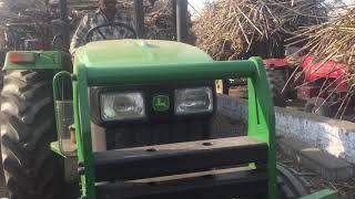 John Deere 5055 E on sugarcane trolley जॉन डीयर ट्रैक्टर गन्ने की ट्राली के साथ।