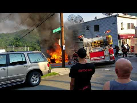 Car on fire - Yonkers - New York - USA. Firefighter's in action