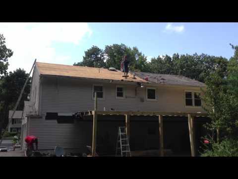 Roofing Contractors BuxMont Construction installing Velux Solar Skylight