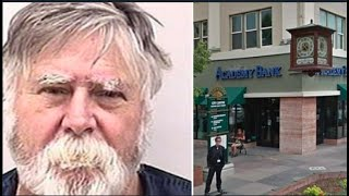 Man with white beard robs bank, throws all the money in the air and shouts 'Merry Christmas'