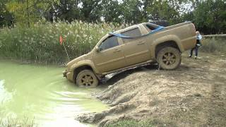 Chevy Avalanche mudding deep at the cliffs offroad park