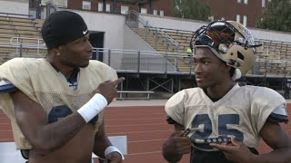 Gallaudet football players communicate with sign language