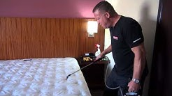 Examining and Treating Hotel Room Beds with Nature-Cide All Purpose
