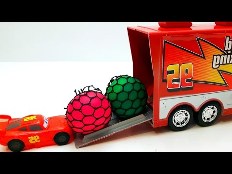 Disney Cars Mack Truck Trailer and Mcqueen Kinder Surprise Eggs Unboxing Squishy Balls M&M