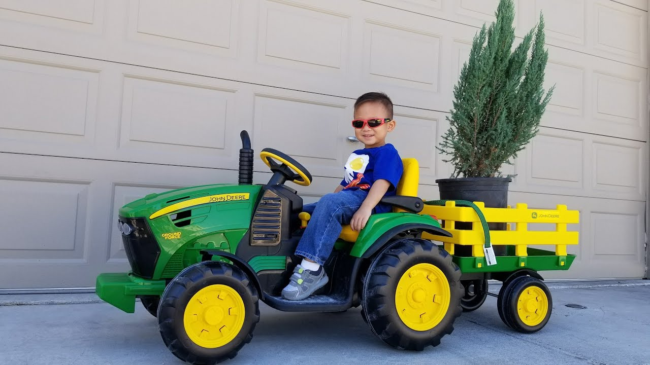 planting trees with my john deere ground force tractor. Black Bedroom Furniture Sets. Home Design Ideas