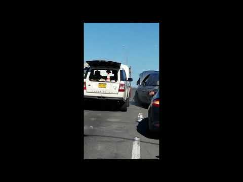 Chassidish Man Boosts Stalled Vehicle on the FDR Drive, Manhattan