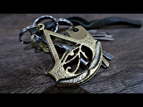 Casting a brass Assassin's Creed Origins Logo Keychain