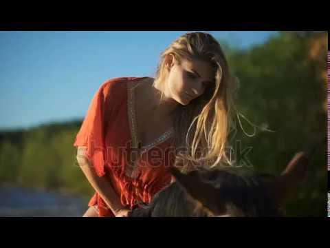 Close up A Sexy Beautiful Young Woman Riding A Horse At A Beach Enjoying thumbnail