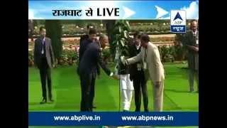 Obama at Raj Ghat: Obama plants Peepal tree sapling I Pays tribute to Mahatma Gandhi