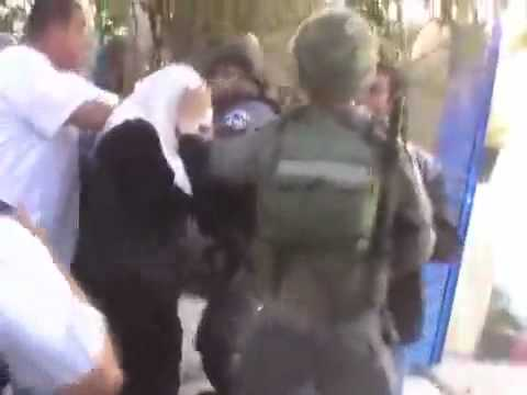 Hijab Woman gets hit on head and touched by Israeli Policeman after eviction thumbnail