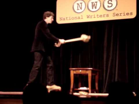 Benjamin Busch takes out a flower pot at the National Writers Series