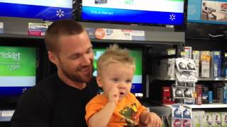 Extreme Makover Fitness Trainer Chris Powell, and son Cash at Walmart watching EMWLE promo