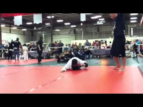 Download Brandon Hoang, Paul Thomas' student, BJJ, gi division, fight on 6/16/2012.