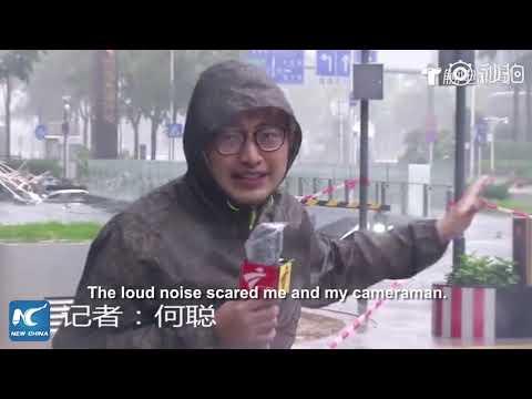 Glass wall of skyscraper falls when reporter doing live report