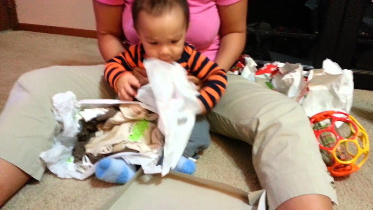 6 month old baby opening christmas presents - What To Get A 6 Month Old For Christmas