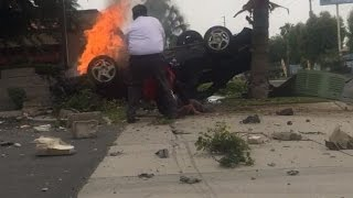 Watch Dramatic Moment Stranger Pulls Man Out of Burning Car