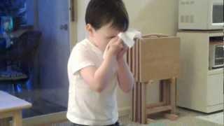 John practicing blowing his nose